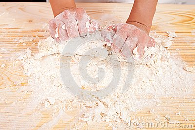 Hands with dough