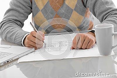 Hands drawing blueprint