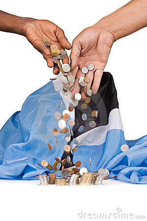 Hands dropping coins on pile