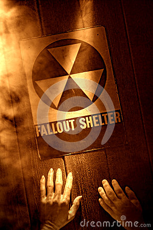 Hands at Fallout Shelter Sign in Nuclear Disaster