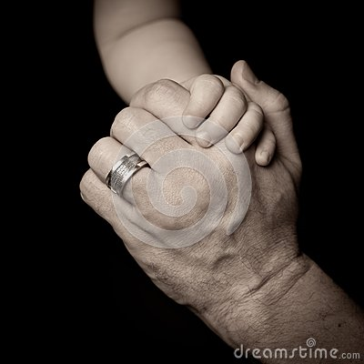 Hands of father and child.