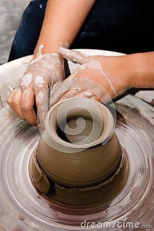Hands of a Female Potter Creating an Earthen Jar