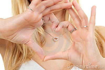 Hands forming love heart shape