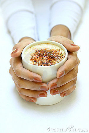 hands gently warming against a cup of coffee