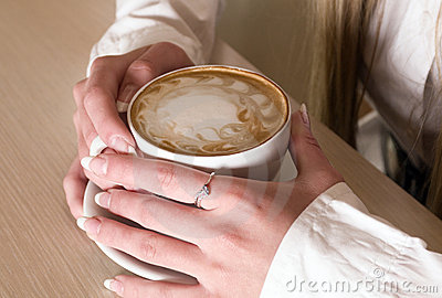 Hands of  girl keeps cup  coffee