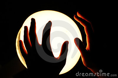 Hands on a Glowing Globe