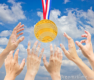 Hands with golden medal.