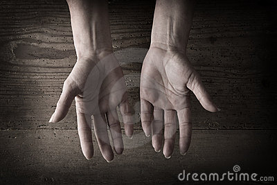 Hands and grainy wood