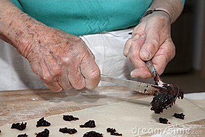 Hands of grandmother at backing