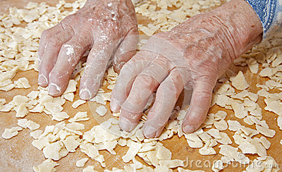 Hands of grandmother at cooking