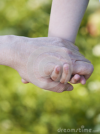Hands of grandson and grandmother