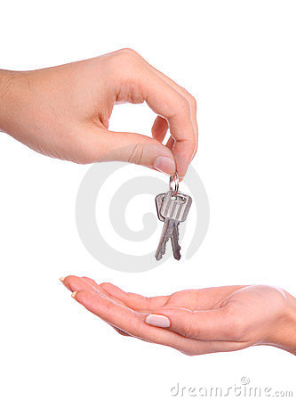 Hands handing over the keys