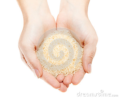 Hands with heap of rice