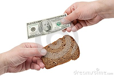 Hands hold the dollar and bread