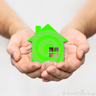 Hands hold green house