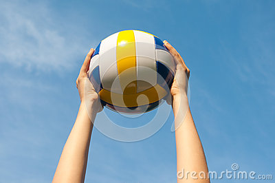 Hands holding ball for volleyball