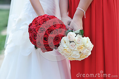 Hands holding bouquet