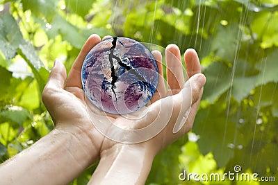 Hands holding broken earth