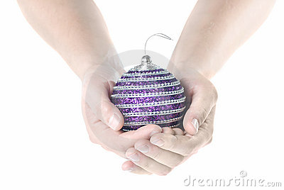 Hands holding christmas pink ball