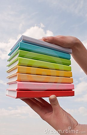 Free Hands Holding Color Hard Cover Books Stock Photography - 20116022