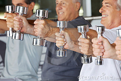 Hands holding dumbbells in gym