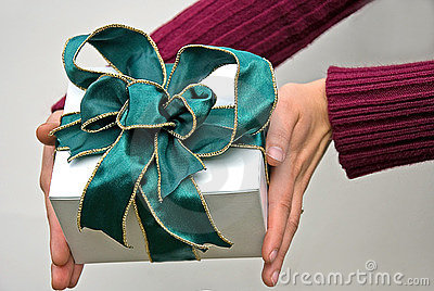 Hands Holding Gift with Green Bow