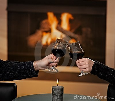 Hands holding glas of wine
