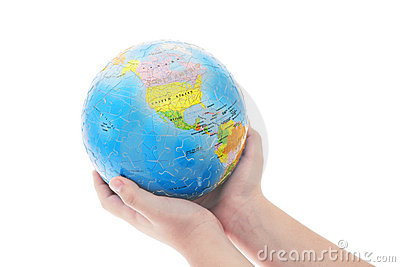Hands holding globe jigsaw puzzle