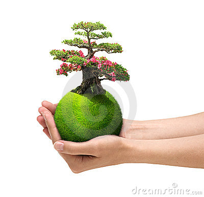 Hands holding green planet