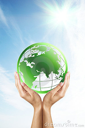 Hands holding a green planet (Earth)