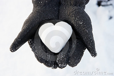 Hands Holding Heart Made Out Of Snow