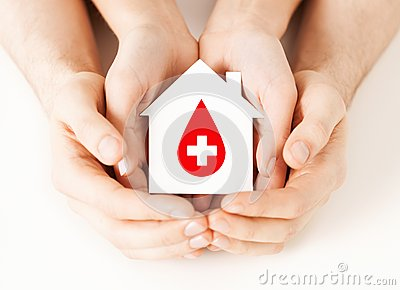 Hands holding house with donor sign
