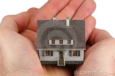 Hands holding a miniature home