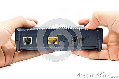 Hands holding a modem.
