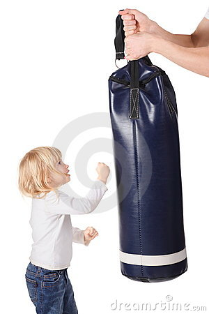 Hands is holding punching bag and girl is punching