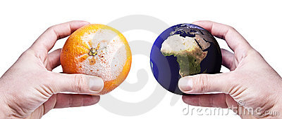 Hands holding a rotten orange and the world