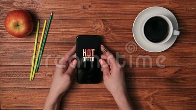 Hands holding smart phone with hot offer on screen stock footage