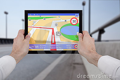 Hands holding a touchpad pc, using the navigation
