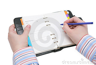 Hands holding writing in organizer