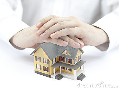 Hands and little yellow house