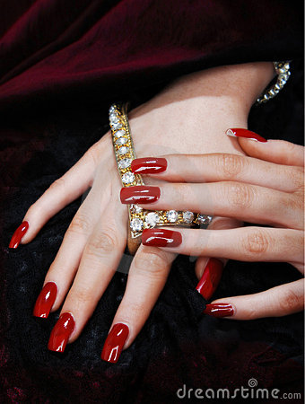Hands with long red nails