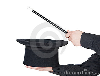 Hands of the magician with magic wand and top hat