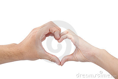 Hands of man and woman forming a heart
