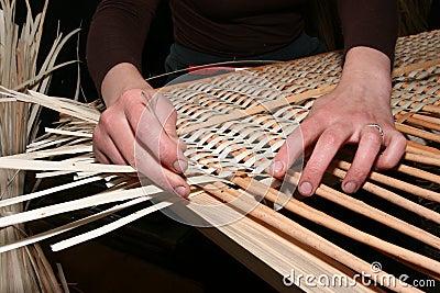 Hands manually mastering wicker fabric 5