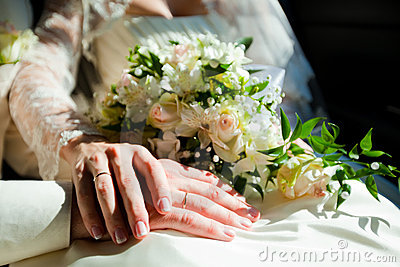 Hands of married couple