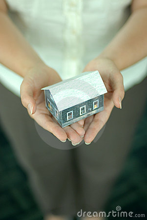 Hands with model of house.