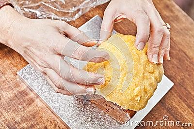 Hands modeling cake icing