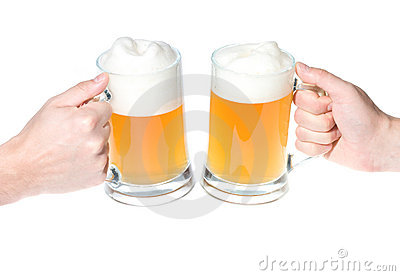Hands with mug of beer cheers