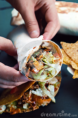 Free Hands Of Chef Holding Burrito Stock Images - 78168604