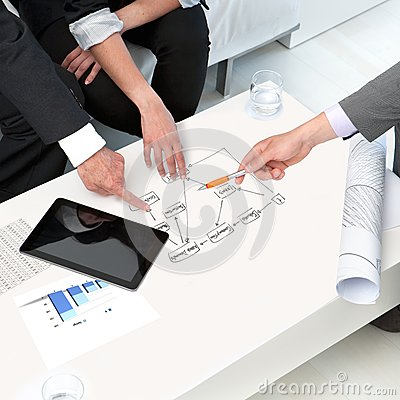 Hands on papers at business meeting.